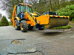 The front end of the Kemach JCB 3CX Pothole Master sports a 2.3 m wide hydraulic sweeper collector shovel with enclosed brush. One or two passes of the planed area is enough to provide a clean work area that is ready for repair and relaying of asphalt