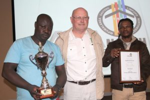 """Gauteng Piling places strong emphasis on site safety and has already won an MBA North Health & Safety award for 'Best Sub-Contractor without a Permanent Site"""". Gauteng Piling's Victor Modau (left) and Sibo Dlomo (right) received the award from Ian Harris, of Amakoro Trading, which sponsors the annual award."""