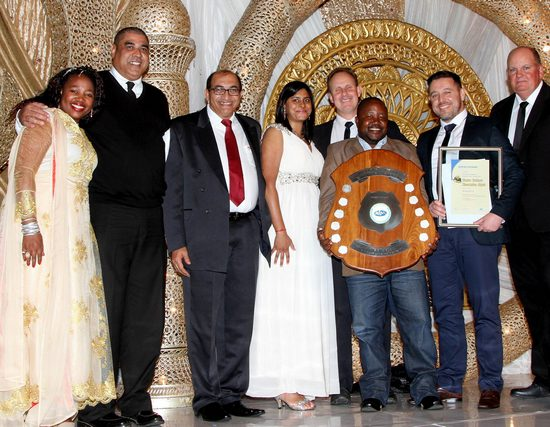 PIC 1-2 Caption:  Winners for the category Projects R500 million and above receiving their award: Jerome Beaunoir – ENZA Construction, SHE officer (first from left); Prithivirajh Sewpersadh – AvengGrinaker-LTA – SHE Officer; Santhisha Rambajan - AvengGrinaker-LTA – Environmental Officer; Stuart Meyer - AvengGrinaker-LTA – Project Director; Derrick Gwala (holding shield) - AvengGrinaker-LTA – Senior SHE Officer; Morne Verwey - AvengGrinaker-LTA – Project Manager; flanked on the left and the right by Itumeleng Leshoedi - Manager: Occupational Health and Safety, MBSA and Neil Cloete, President, MBSA.